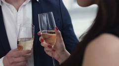 Young Couple Toasting champagne In Restaurant. Dating. Young man and woman  Stock Footage