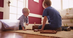 Two young boys playing with wooden blocks Stock Footage