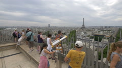 People and top view of the city on the Arc de Triomphe in Paris Stock Footage