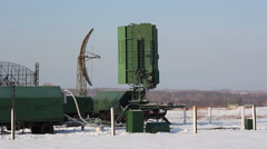 Green military radar station rotates in winter. Stock Footage