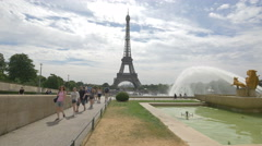 Walking next to the Fountain of Warsaw, in Trocadero Gardens, Paris Stock Footage