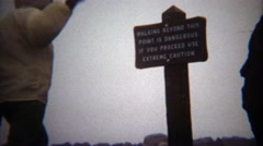 1971: Walking past this sign is extremely dangerous proceed with caution. Stock Footage