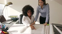 Female Architect Colleague Shows Building Plan To Manager Stock Footage