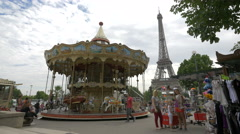 Merry go round and a souvenir stall on Avenue des Nations Unies in Paris - stock footage