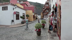 People visit souvenir shops at Garachico, Tenerife Stock Footage