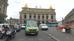 Cars and buses driving and people near Palais Garnier in Paris Stock Footage