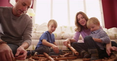 Portrait of a white happy family playing together - stock footage