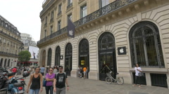 People walking in front of an Apple Store on Rue Mayerbeer in Paris - stock footage