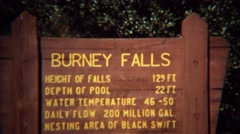 1971: Burney waterfall sign and cold majestic blue pools. Stock Footage