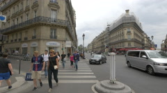 People walking and cars driving on Rue de Ventadour in Paris Stock Footage