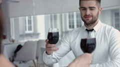 Young happy couple romantic date drink glass of red wine at restaurant Stock Footage