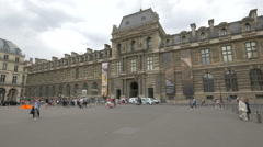 View of the facade of Musee du Louvre in Paris Stock Footage