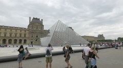 Taking pictures near the Louvre Pyramid in the Napoleon Courtyard, Paris Stock Footage