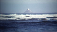 1971: Magic island floating above ocean in near fata morgana mirage. Stock Footage