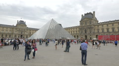 Taking pictures next to the Pyramide du Louvre in the Napoleon Courtyard, Paris Stock Footage