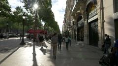 Walking next to Guerlain store and Marriott Hotel on Champs-Elysees in Paris Stock Footage