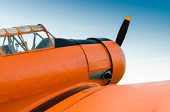 Adventure in the sky, Old airplane, orange, North American T-6G Texan.. - stock photo
