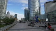 Walking and resting near the Sculptures de Joan Miro, La Défense, Paris Stock Footage