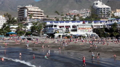 Playa Fanabe beach with a shopping arcade with restaurants and shops, Tenerife Stock Footage