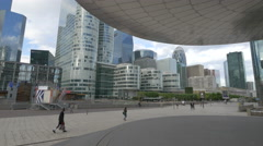 Tourists and locals walking in La Défense, Paris Stock Footage
