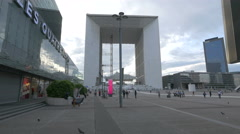 Stock Video Footage of Tourists walking in front of the La Grande Arche in La Défense, Paris