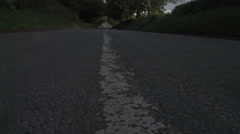 Traveling Down An English Countryside Road At Sunset - stock footage