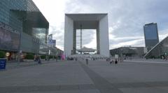 Walking next to the Les Quatre Temps and La Grande Arche in La Défense, Paris Stock Footage
