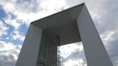 Stock Video Footage of Low angle view of La Grande Arche and a cloudy sky in La Défense, Paris