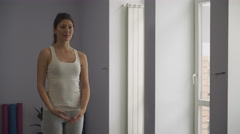 Woman doing yoga exercises with closed eyes. Stock Footage