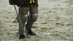 Blistering attack of brave medieval knight on rival in tournament reenactment Stock Footage