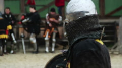 Two men wearing ancient suits reenacting medieval martial arts tournament Stock Footage
