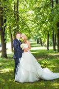 Bride and groom in park summer  outdoor Stock Photos