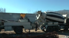 Concrete mixer in construction site. - stock footage