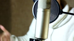 The guy singing in the Studio Stock Footage