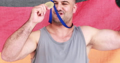 Discus thrower holding medal Stock Footage