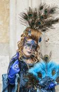 Peacock Disguised Woman - Venice Carnival 2014 - stock photo