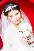 Brunette bride portrait fashion with tiara and wedding bouquet Stock Photos