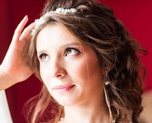 portrait of bride with fashion wedding hairstyle and tiara - stock photo