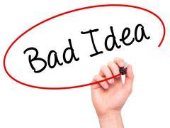 Man Hand writing Bad Idea with black marker on visual screen. - stock photo