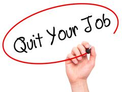 Man Hand writing Quit Your Job with black marker on visual screen. Stock Photos