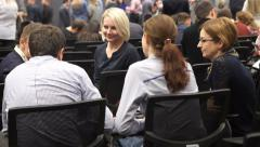 Girls discuss after the seminar and clap - stock footage