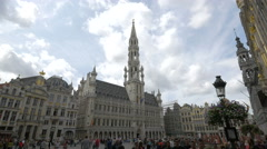 Tourists walking in front of the City hall of Brussels Stock Footage