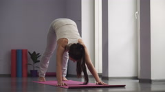 Woman practicing yoga in fitness hall Stock Footage