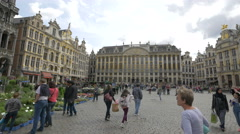 Tourists buying flowers and walking in Grand Place, Brussels Stock Footage