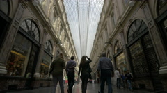 Low angle view of people walking in Saint-Hubert Royal Galleries, Brussels Stock Footage