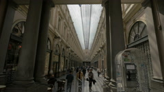 Tourists walking in the Royal Galleries glazed shopping arcade, Brussels Stock Footage