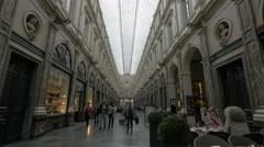 Men and women walking inside Les Galeries Royales Saint-Hubert, Brussels Stock Footage
