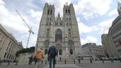 People walking towards the St Michael and St Gudula Cathedral in Brussels Stock Footage