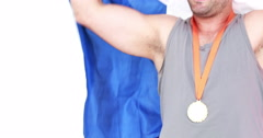 Happy athlete with medal holding flag Stock Footage