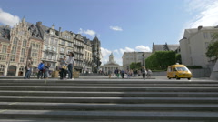 Tourists walking around the Whirling Ear fountain in Brussels Stock Footage